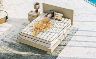 mattress myths - person lying on saatva mattress