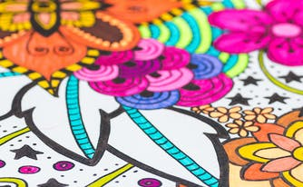 coloring page with markers on top of it
