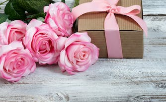 bunch of roses and gift box for mother's day