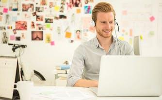 saatva customer service agent on computer with headset