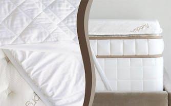 mattress pad and mattress topper next to each other