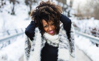 winter sleep tips - image of woman outside in winter getting sunlight