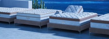 saatva mattresses lined up outside