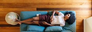 person napping on couch during afternoon