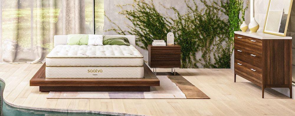 saatva classic innerspring mattress inside forest-themed bedroom