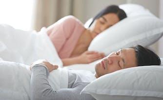best mattress for adjustable base - image of couple lying on adjustable base