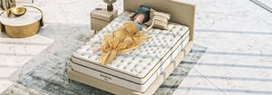 person lying on top of mattress