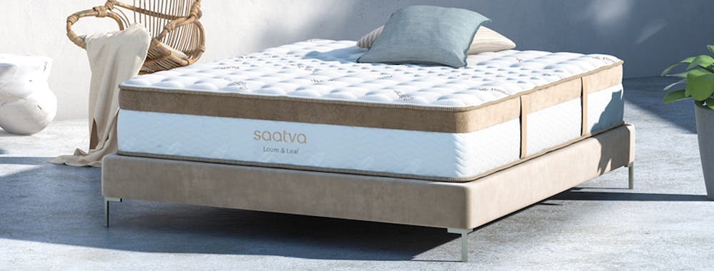 saatva memory foam mattress outside with chair next to it