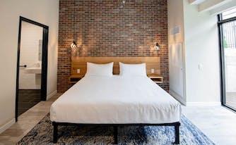 maj hotel bedroom featuring a saatva mattress