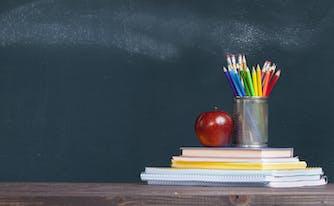 saatva teachers discount - image of chalkboard, pencils, apple, and stack of books