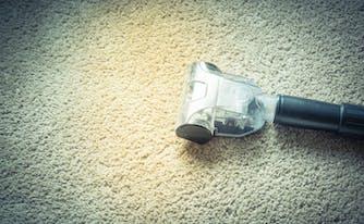 allergy-proof bedroom - image of vacuum cleaner on carpet