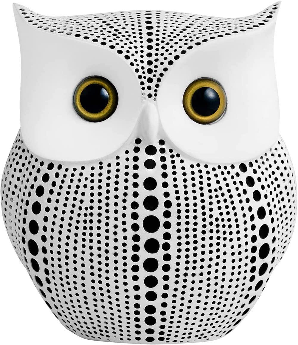 black and white spotted owl statue