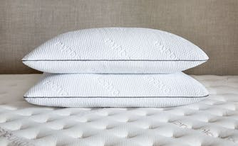 saatva memory foam pillows stacked on bed