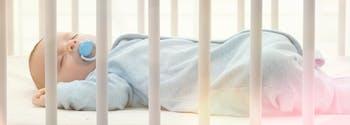 baby sleeping on crib mattress