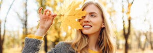 person holding leaf outside in the fall
