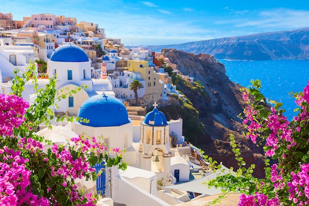 View of blue-domed buildings on Santorini, Greece on a cliffside