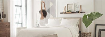 image of person stretching on innerspring mattress
