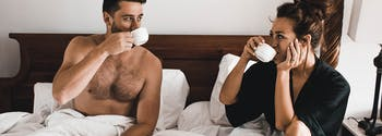 what your side of the bed says about you - image of couple in bed