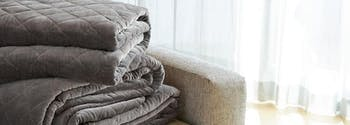 saatva organic weighted blanket folded on couch
