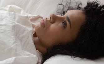 image of person awake in bed