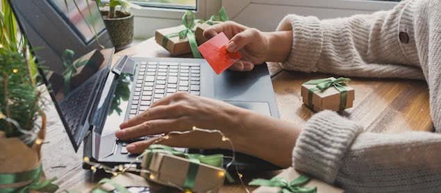 person shopping on laptop during cyber monday sales