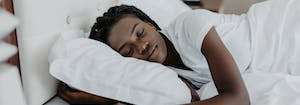 best hybrid mattress for side sleepers - image of person sleeping on side
