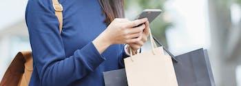 mattress shopping - image of woman holding shopping bags