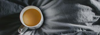remove stains from sheets - image of coffee cup on sheets