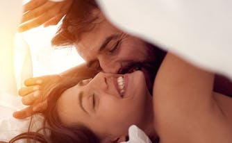 image of happy couple in bed