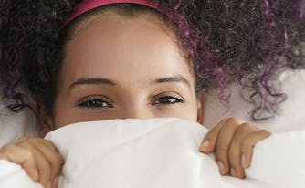 image of woman with sensitive skin under sheets