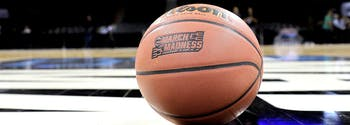 how to use sleep science to fill out march madness bracket - image of basketball on ncaa tournament court