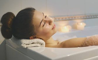 image of person taking relaxing bath before bed