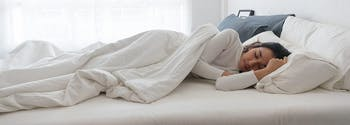 best latex mattress for side sleepers - image of woman sleeping on side