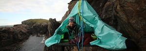image of Phoebe Smith n her portaledge on a mission to raise money and awareness about youth homelessness through adventure
