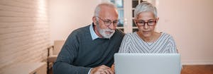 image of couple reading mattress customer reviews online