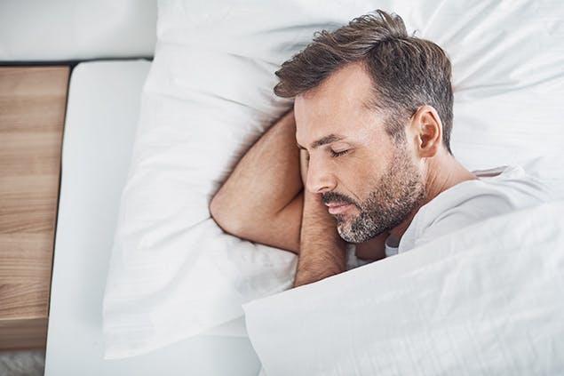 image of man sleeping in bed