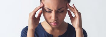 image of woman with exploding head syndrome sleep disorder