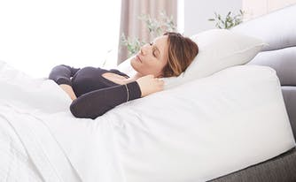 image of woman on adjustable air bed to relieve back pain