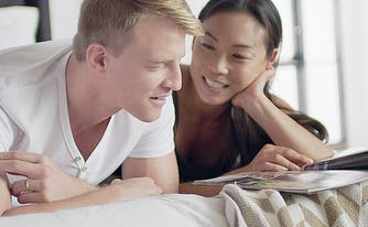 How to pick the best mattress - couple lying in bed