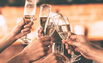 image of champagne toast - sleep tips for holidays