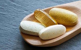 vitamin deficiency - image of spponful of vitamins