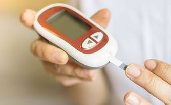 image of person with diabetes checking blood sugar