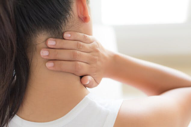 Person massaging stiff neck