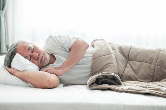 best mattress for elderly people - image of senior citizen in bed