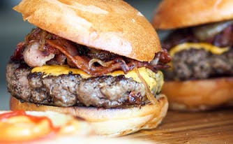 foods to avoid before bed - image of bacon cheeseburger