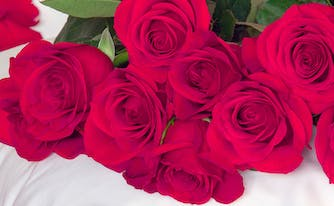 image of roses on pillow - romantic bedroom ideas
