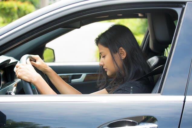 sleep myths - person falling asleep in car