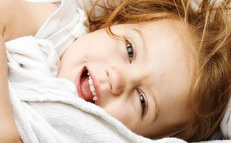 image of little girl in bed