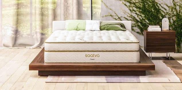 eco-friendly saatva mattress in bedroom with plants