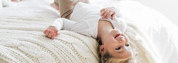 best kids mattress - image of little girl on bed